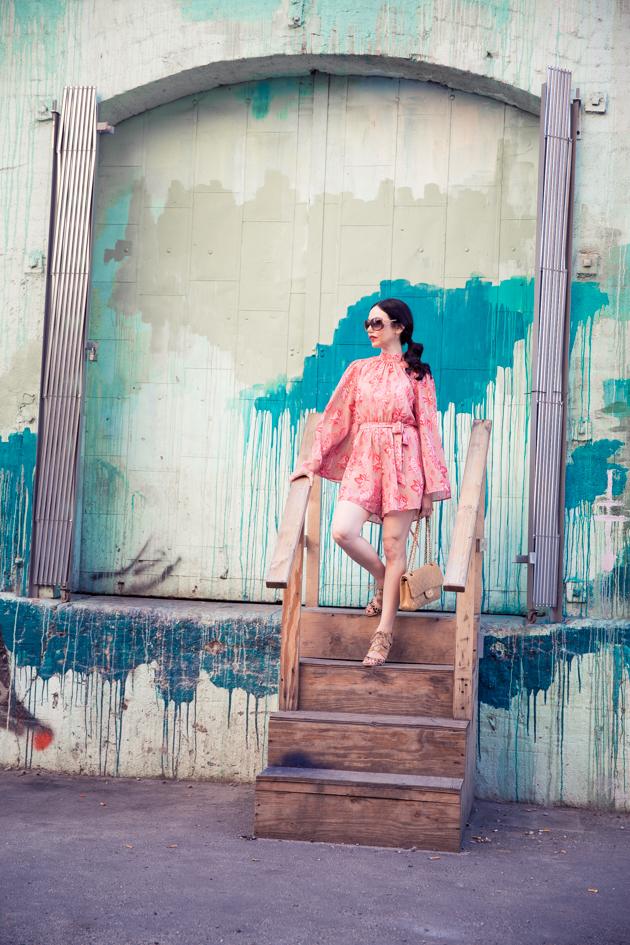 Lisa Valerie Morgan wears Metisu Pink Romper