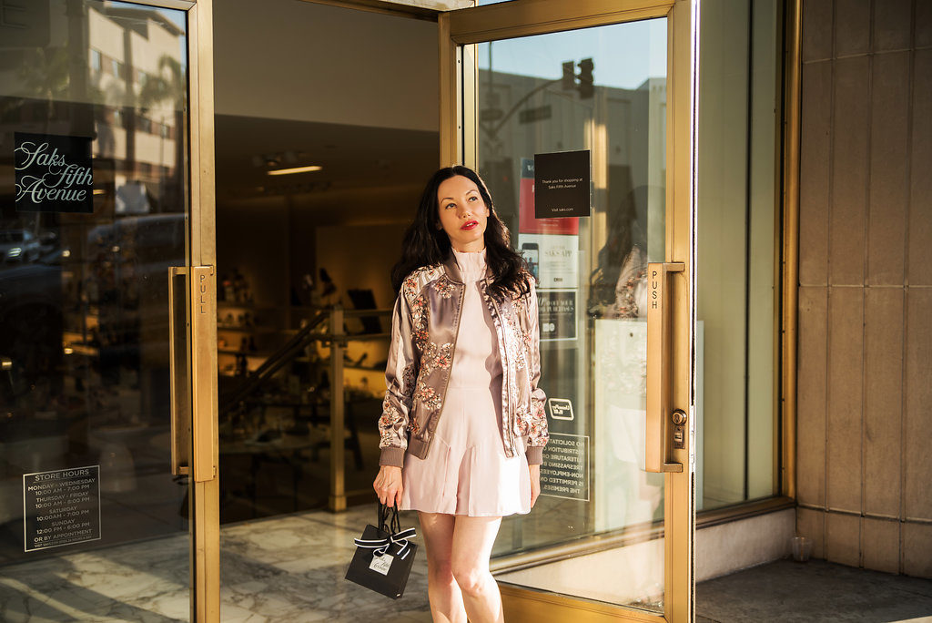 Pretty Little Shoppers Blog wears Lovers and Friends Bomber Jacket