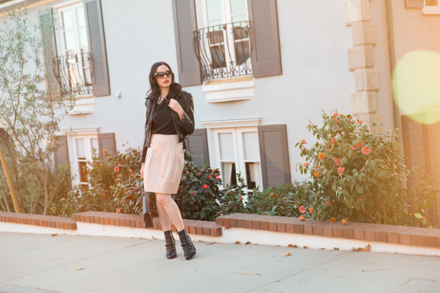 How to Dress Like a Londoner, styling tips featured by top LA fashion blog, Pretty Little Shoppers: image of a woman wearing Juicy Couture leather jacket, Alice & Olivia blouse, Anthropologie skirt, Tommy Hilfiger booties, and a Chanel bag.