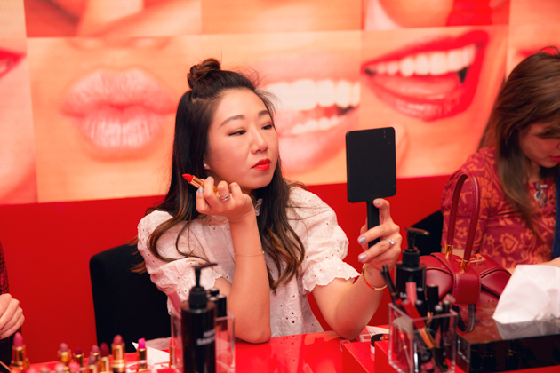 Sheree Ho tries on lipstick at Chanel Beauty House