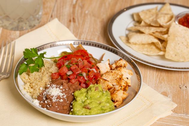 Mucho Delicious Bowl, Achiote Chicken, Quinoa, Refried Beans, Guacamole, Pico de Gallo, Sauteed Bell Peppers and Onions, Cojita Cheese