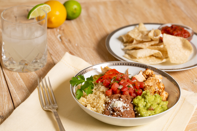 Mucho Delicious Bowl, Ahiote Chicken, Quinoa, Refried Beans, Guacamole, Pico de Gallo, Sauteed Bell Peppers and Onions