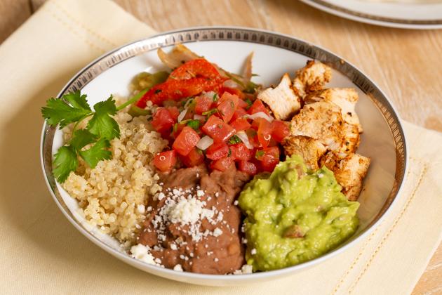 Mucho Delicious Bowl, Ahiote Chicken, Quinoa, Refried Beans, Guacamole, Pico de Gallo, Sauteed Bell Peppers and Onions, Cojita Cheese