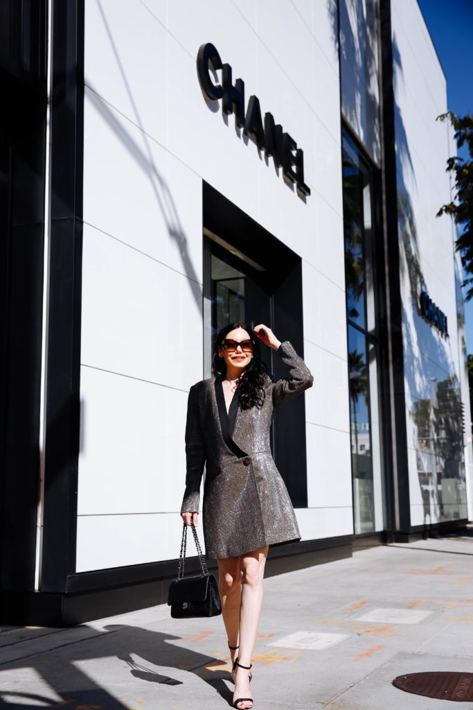 How to Style a Blazer Dress, tips featured by top LA fashion blog, Pretty Little Shoppers: image of a woman wearing a Bronx & Marco blazer dress, Steve Madden sandals, Chanel bag, and Oliver Peoples sunglasses. | How to Style A Blazer Dress, Bronx and Banco, Revolve Clothing, Nuuly, Winter Fashion, Winter Style, Shop till you drop, Fashion Influencer, Quilted Chanel Bag, Winter Trends, Who What Wearing, Fashion Blogger Style, Outfit Inspiration, Street Style, Street Fashion, OOTD Inspo, Street Style Stalking, Seasonal Style, What to Wear in Winter, Beverly Hills Style #bronxandbanco #mynuuly #fashionblogger #lafashionblogger #streetstyle #Winterfashion #parisianchic #blazerdress