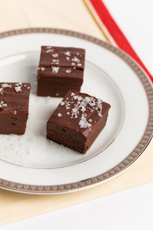 Adaptogen Chocolate Fudge, Essential Living Foods Organic Coco Gogo Smoothie Mix,  Healthy Chocolate Fudge Recipe, Gluten-Free Living, Healthy Holiday Recipe Ideas, Gluten-free Holiday Recipes, Christmas Recipe Ideas, Countertop Cocoa Butter Ghee, Fudge Made with Ghee, Aryuvedic Recipes, Essential Living Foods, Cacao Powder, Lucuma, Mesquite, Sweetened Condensed Coconut Milk, Enjoy Life Chocolate Chips, Pretty Little Shoppers Blog. Entertaining Ideas #adaptogens #essentiallivingfoods #fudgerecipe