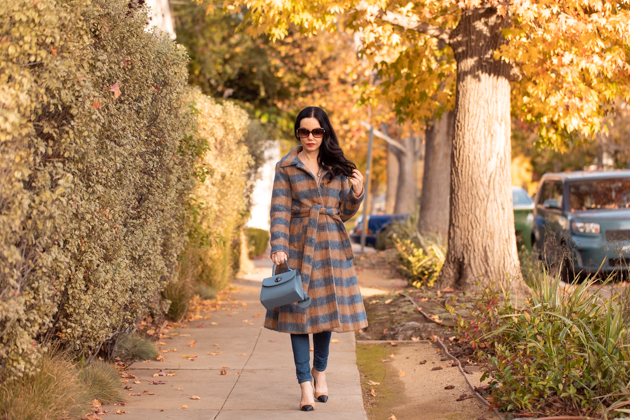 Statement coat styled by top Los Angeles fashion blog, Pretty Little Shoppers: image of a woman wearing an Urban Outfitters plaid wool statement coat. | It's All About the Coat, Plaid Coat, Urban Outfitters Coat, How to style a Statement Coat, Winter Fashion, Winter Style, Shop till you drop, Nuuly Rental Service, Joseph and Stacey, Anthropologie Blouse, Wool Coat, Who What Wearing, Mad About Plaid, Fashion Blogger Style, Outfit Inspiration, Street Style, Street Fashion, OOTD Inspo, Street Style Stalking, Seasonal Style #mynuuly #fashionblogger #lafashionblogger #streetstyle #Winterfashion #StatementCoat #WinterCoat