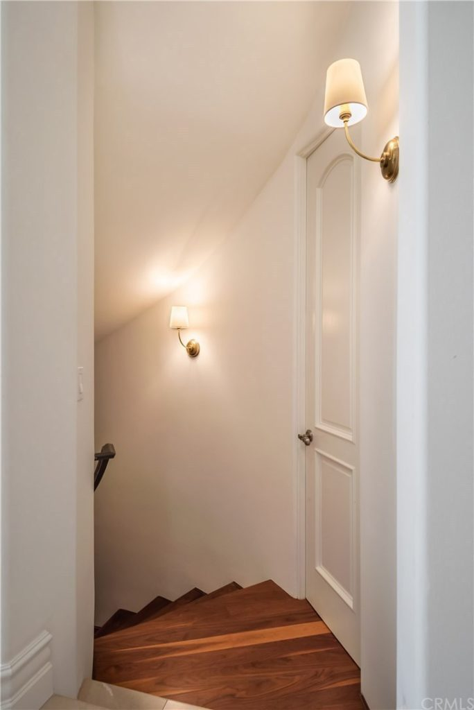 Basement Stairwell Sconces After, Lighting Makeover with Visual Comfort, Home Remodel, Lighting Fixtures Before and After, Visual Comfort Lighting, Chandeliers, Sconces, Home Makeover, House Update, Luxury Home, Real Estate, How to update your home with new lighting, Easy Home Makeover, Manhattan Beach Home, Home Interior, Home Decor #VisualComfort #HomeMakeover | Visual Comfort Lighting by popular LA life and style blog, Pretty Little Shoppers: image of a Visual Comfort Vendome single sconce.