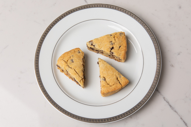 Gluten-free Chocolate Chip Scones, Healthy Breakfast Ideas, Gluten-free recipes, Gluten and Dairy-Free Chocolate Chip Scones, Gluten-free Living, Food Blogger, Foodie, Mouth Watering Recipes, Healthy Eating, Organic Eating, Gluten Free Baking, High Tea Scones, Easy and Healthy Recipes, healthy brunch ideas, picnic menu, #organicliving #glutenfreerecipe #glutenfreebaking #organiceating #HighTea #glutenfreebreakfastideas #brunch #foodie #chocolatechipscones | Chocolate Chip Scones by popular L.A. lifestyle blog, Pretty Little Shoppers: image of chocolate chip scones on a white ceramic plate.