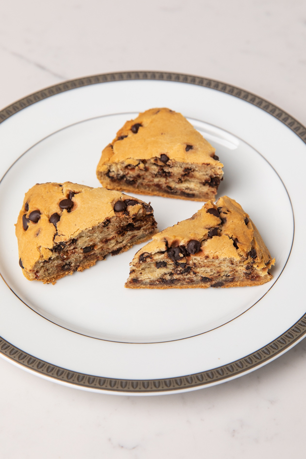 Gluten-free Chocolate Chip Scones, Healthy Breakfast Ideas, Gluten-free recipes, Gluten and Dairy-Free Chocolate Chip Scones, Gluten-free Living, Food Blogger, Foodie, Mouth Watering Recipes, Healthy Eating, Organic Eating, Gluten Free Baking, High Tea Scones, Easy and Healthy Recipes, healthy brunch ideas, picnic menu, #organicliving #glutenfreerecipe #glutenfreebaking #organiceating #HighTea #glutenfreebreakfastideas #brunch #foodie #chocolatechipscones   Chocolate Chip Scones by popular L.A. lifestyle blog, Pretty Little Shoppers: image of chocolate chip scones on a white ceramic plate.