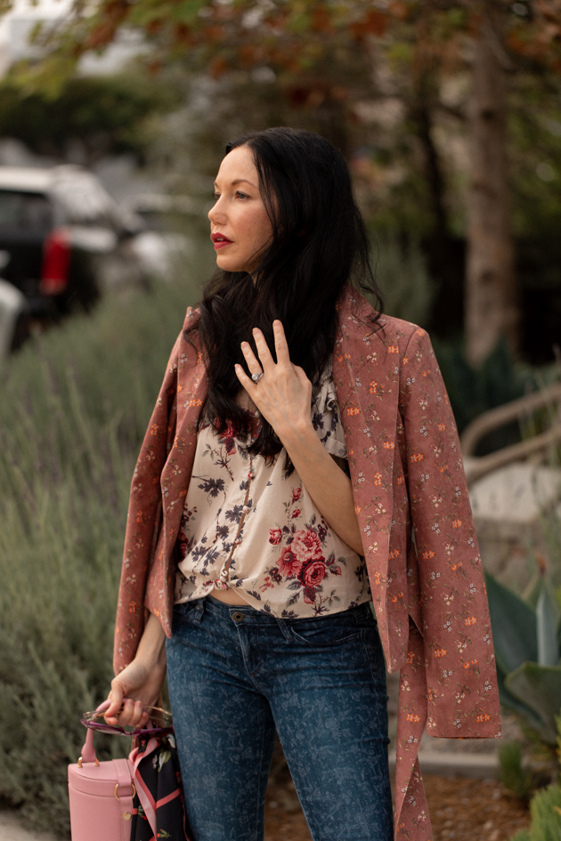How to Style Floral Prints | Floral Prints by popular L.A. fashion blog, Pretty Little Shoppers: image of woman wearing a floral blouse, floral print jeans, Pimpinela Corduroy Jacket, and stiletto heels.