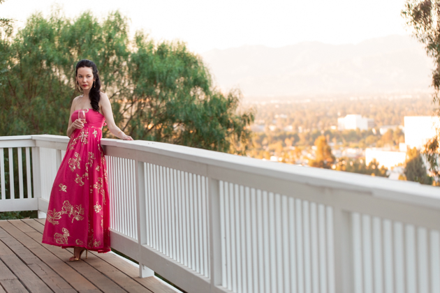 Date Night at Home: Strapless Dress | Strapless Dress by popular L.A. fashion blog, Pretty Little Shoppers: image of a woman standing outside on a balcony and wearing a Free People Women's Baja Babe Midi Dress.