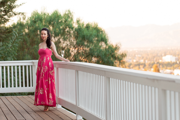What to wear for a Date Night at Home | Strapless Dress by popular L.A. fashion blog, Pretty Little Shoppers: image of a woman standing outside on a balcony and wearing a Free People Women's Baja Babe Midi Dress.