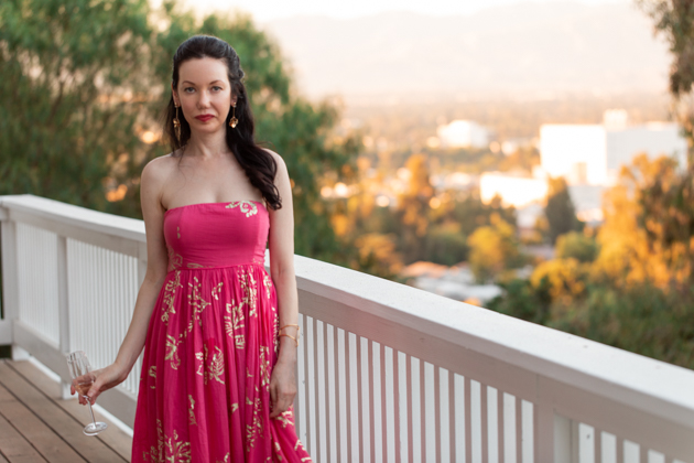 Lisa Valerie Morgan wears Free People Strapless Dress | Strapless Dress by popular L.A. fashion blog, Pretty Little Shoppers: image of a woman standing outside on a balcony and wearing a Free People Women's Baja Babe Midi Dress.