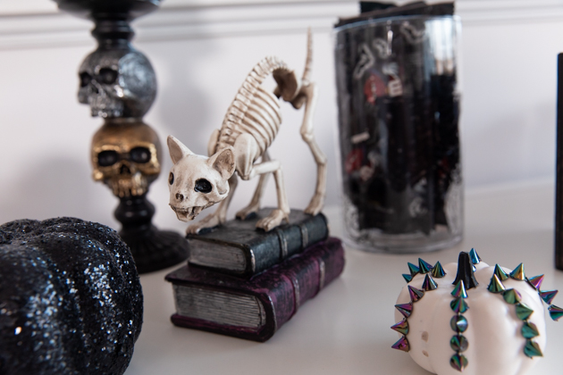 Celebrating Halloween In My New House, Halloween Ideas, How to Celebrate Halloween at Home, Halloween Ideas during Covid-19 Quarantine, Los Angeles Lifestyle Blogger, Pretty Little Shoppers Blog, Halloween Decorations #Halloween2020 |Cheese Platter by popular LA lifestyle blog, Pretty Little Shoppers: image of a skeleton cat, black glitter pumpkin, white pumpkin, and skull candle holder.