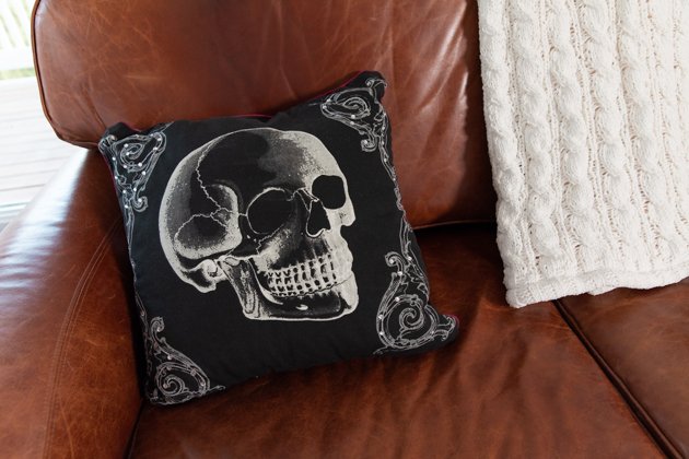 Halloween Skeleton Pillow |Cheese Platter by popular LA lifestyle blog, Pretty Little Shoppers: image of a black skeleton pumpkin.