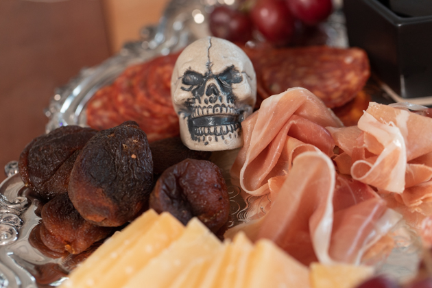 Halloween Cheese Platter and Candy Buffet, Celebrating Halloween In My New House, Halloween Ideas, How to Celebrate Halloween at Home, Halloween Ideas during Covid-19 Quarantine, Los Angeles Lifestyle Blogger, Pretty Little Shoppers Blog, Halloween Decorations #Halloween2020 #HalloweenCheesePlatter |Cheese Platter by popular LA lifestyle blog, Pretty Little Shoppers: image of a tiny skull on a meat and cheese platter.