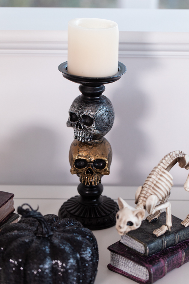 Halloween Cheese Platter and Candy Buffet, Celebrating Halloween In My New House, Halloween Ideas, How to Celebrate Halloween at Home, Halloween Ideas during Covid-19 Quarantine, Los Angeles Lifestyle Blogger, Pretty Little Shoppers Blog, Halloween Decorations #Halloween2020 |Cheese Platter by popular LA lifestyle blog, Pretty Little Shoppers: image of a skull candle holder, cat skeleton, and black glitter pumpkin.