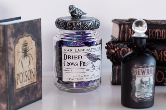 Halloween Candy Buffet, Celebrating Halloween In My New House, Halloween Ideas, How to Celebrate Halloween at Home, Halloween Ideas during Covid-19 Quarantine, Los Angeles Lifestyle Blogger, Pretty Little Shoppers Blog, Halloween Decorations #Halloween2020 #HalloweenCandy  Cheese Platter by popular LA lifestyle blog, Pretty Little Shoppers: image of a apothecary candy jar, black apothecary jar, and potion books.