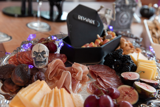 Halloween Cheese Platter and Candy Buffet, Celebrating Halloween In My New House, Halloween Ideas, How to Celebrate Halloween at Home, Halloween Ideas during Covid-19 Quarantine, Los Angeles Lifestyle Blogger, Pretty Little Shoppers Blog, Halloween Decorations #Halloween2020 #HalloweenCheesePlatter |Cheese Platter by popular LA lifestyle blog, Pretty Little Shoppers: image of a meat and cheese platter with a coffin shaped candy dish.