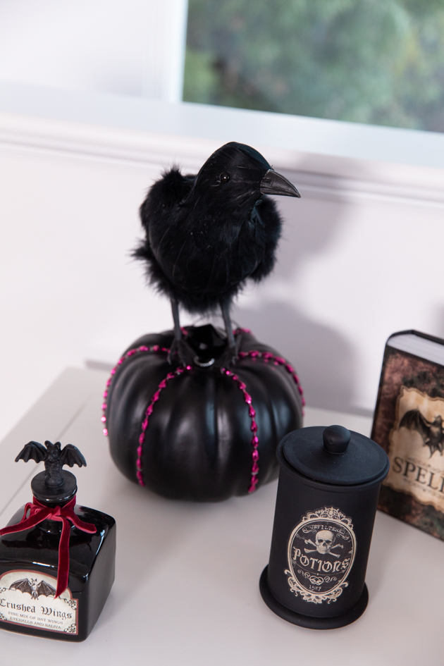 Celebrating Halloween In My New House, Halloween Ideas, How to Celebrate Halloween at Home, Halloween Ideas during Covid-19 Quarantine, Los Angeles Lifestyle Blogger, Pretty Little Shoppers Blog, Halloween Decorations #Halloween2020 | Cheese Platter by popular LA lifestyle blog, Pretty Little Shoppers: image of a black crow, black pumpkin, and black apothecary bottles.