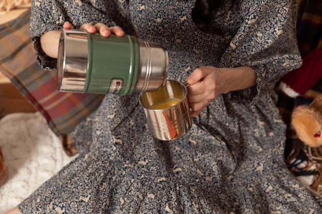 Stanley Thermos with Creamy Delicata Squash Soup |Fall Picnic by popular LA lifestyle blog, Pretty Little Shoppers: image of a woman pouring some soup from a thermos.