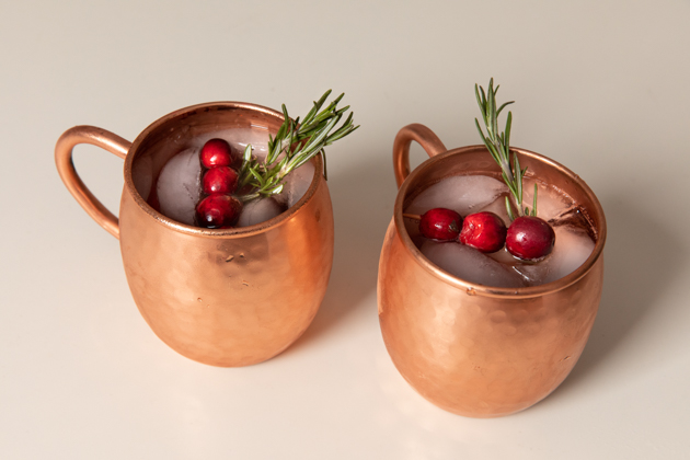 Holiday Moscow Mule, Christmas Cocktail Ideas, Thanksgiving Cocktail Ideas, Festive Holiday Drinks, Home Bar, Home Interior, How to Celebrate the Holidays at Home, Holiday Ideas During Covid Quarantine, Yule Mule, Holiday Moscow Mocktail Los Angeles Lifestyle Blogger, Pretty Little Shoppers Blog #holidaymoscowmule #yulemule #holidaymoscowmocktail | Moscow Mule Recipe by popular LA lifestyle blog, Pretty Little Shoppers: image of a Moscow Mule in two copper mugs.