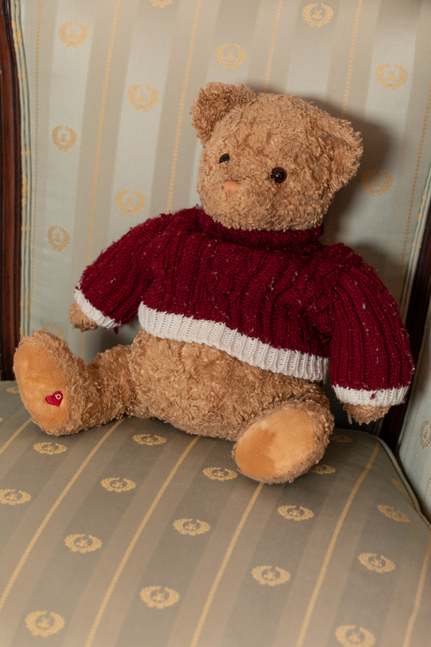 Adorable Stuffed Teddy Bear from Bloomingdales |Velvet Dress by popular LA fashion blog, Pretty Little Shoppers: image of a teddy bear on a armchair.