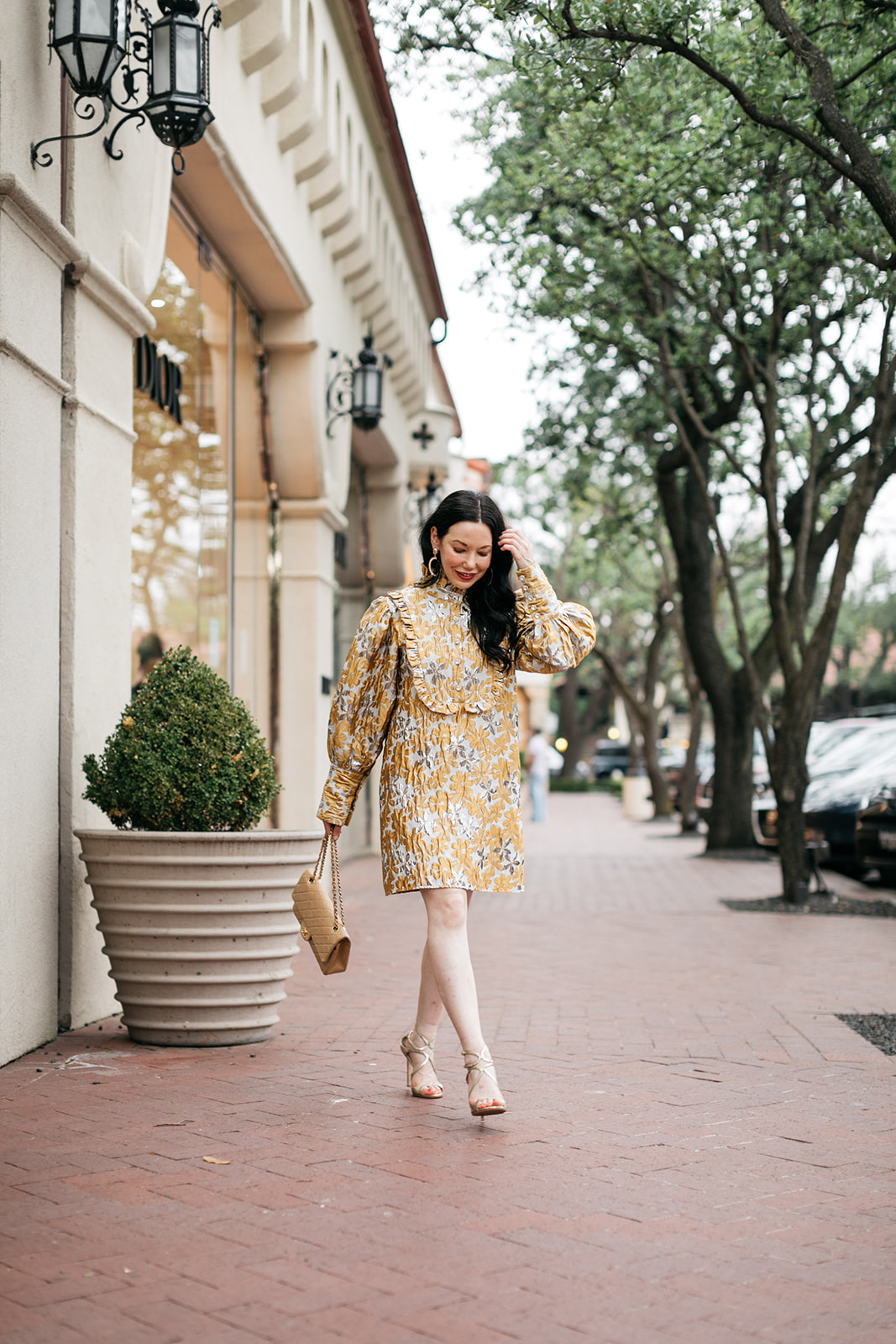 Sister Jane Cocktail Dress, Quilted Chanel Bag   Cocktail Dress by popular Dallas fashion blog, Pretty Little Shoppers: image of a woman walking outside on a brick paved sidewalk and wearing a Sister Jane Cocktail Dress, Chanel Bag, Jimmy Choo Sandals, and Ettika earrings.