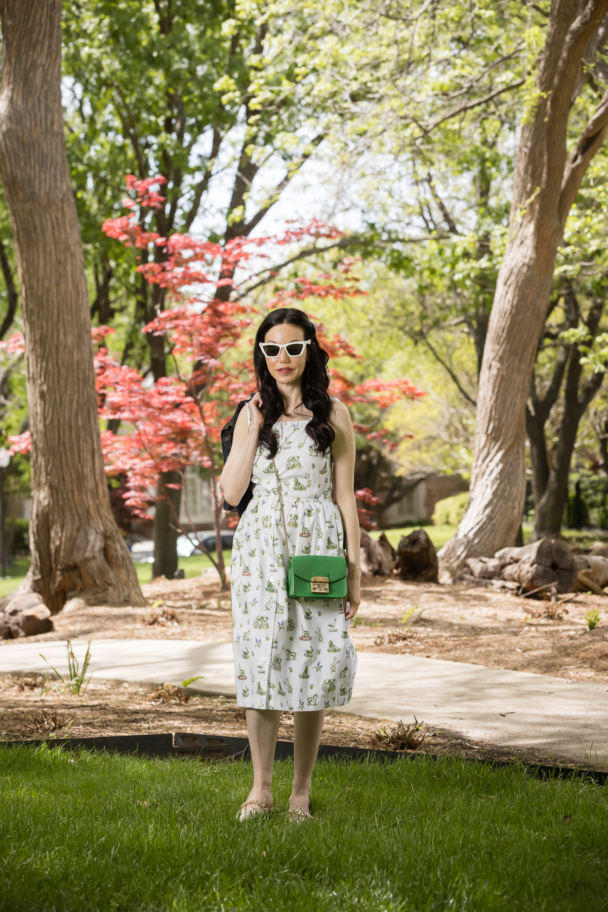 Lisa Valerie Morgan from Pretty Little Shoppers Blog wears Sarah Patrick Collection Newport Topiary Gardens Dress with Green Furla Crossbody Bag
