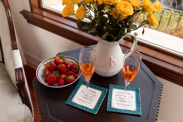 Casa Luigi Prosecco, Yellow Roses, Fresh Strawberries, Downton Abbey Cocktail Napkins   Online Vintage Clothing by popular Dallas fashion blog, Pretty Little Shoppers: image of two wine flutes placed next to a bowl of fresh strawberries and vase of yellow roses.