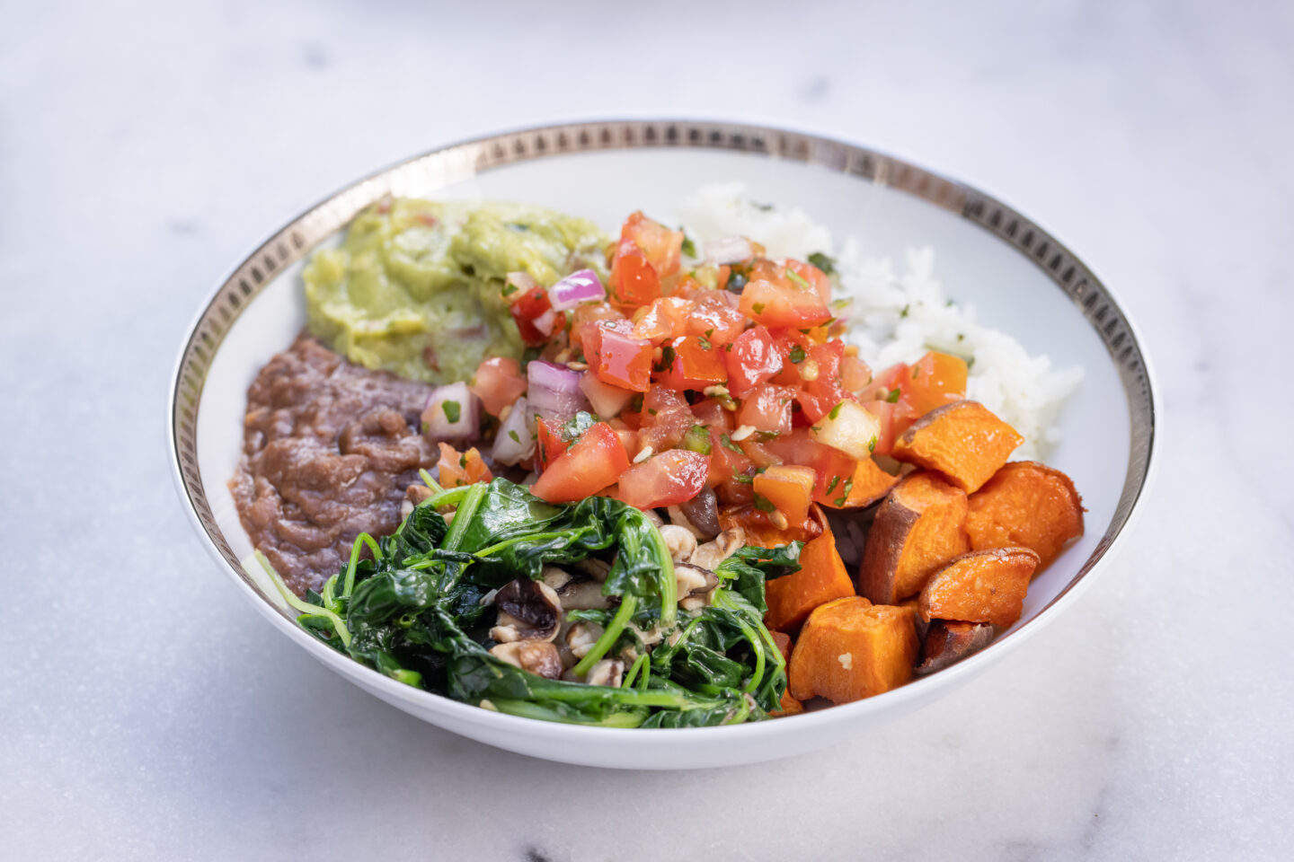 Sweet Potato, Black Bean and Cilantro Lime Rice Burrito Bowl with Sauteed Greens and Mushrooms, Pico de Gallo and Guacamole served with Siete Grain Free Chips and Salsa, Healthy Recipes, Vegan Recipes, Mexican Buddha Bowl, Gluten Free Recipes   Burrito Bowl by popular Dallas lifestyle blog, Pretty Little Shoppers: image of a sweet potato, black bean and cilantro lime rice burrito bowl.