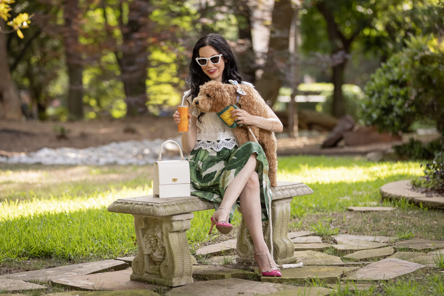 Palm Print Skirt, Neely & Chloe Bag, White Lace Top, Pink Pumps, Fashion Blogger, Fall Transitional Style, Mini Goldendoodle puppy, Fashion Blogger, Presto Sparkling Cuvee   Palm Print Skirt by popular Dallas fashion blog, Pretty Little Shoppers: image of a woman holding her dog outside and wearing a palm print skirt, lace cropped top, and pink heels.
